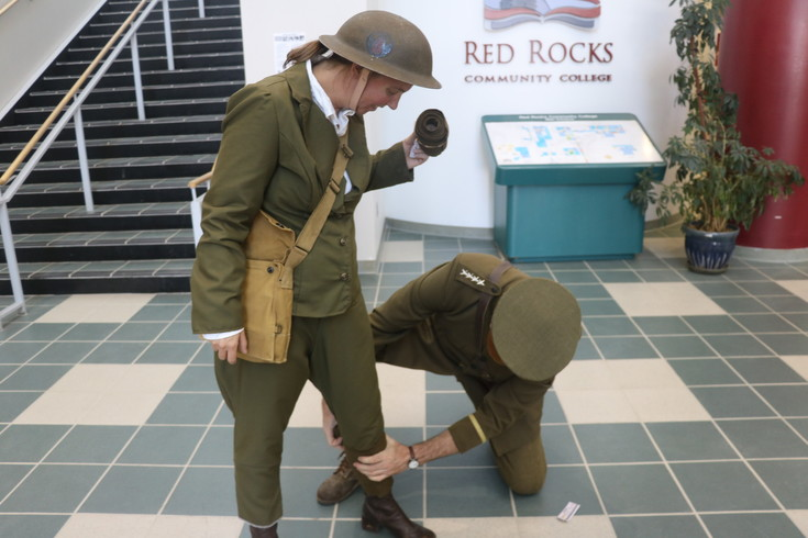 Red Rocks Community College instructor, Don Cygan (dressed as General John Pershing), shows Linnie Pawlke, lead history professor, how to keep her feet dry during the school's World War I day on April 6.