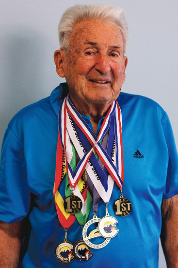 Parker resident Gene Haas sports his medals from competitions including pickleball, skiing and tennis. Haas, 90, says he's encouraged that women's rights have made progress in his lifetime, but as a former member of NOAA, he's concerned about climate change.