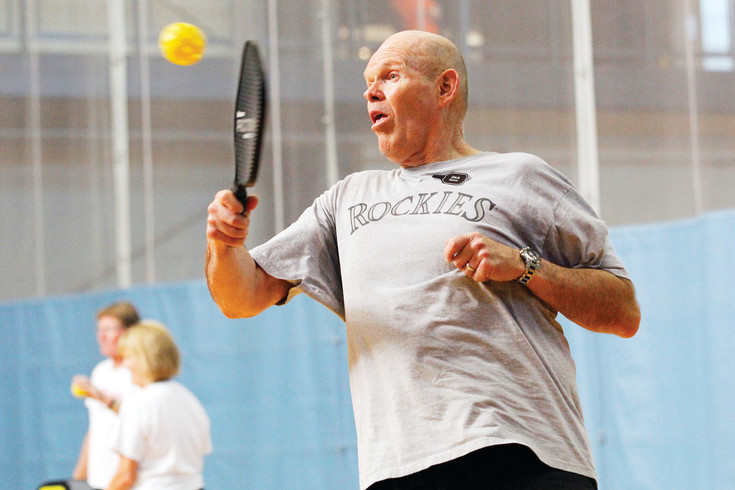 Dick Barton of Parker returns a volley during a drop-in pickleball match at the Parker Fieldhouse. Barton describes the game as a combination of badminton, ping-pong and tennis, but adds that pickleball is played at a faster pace.