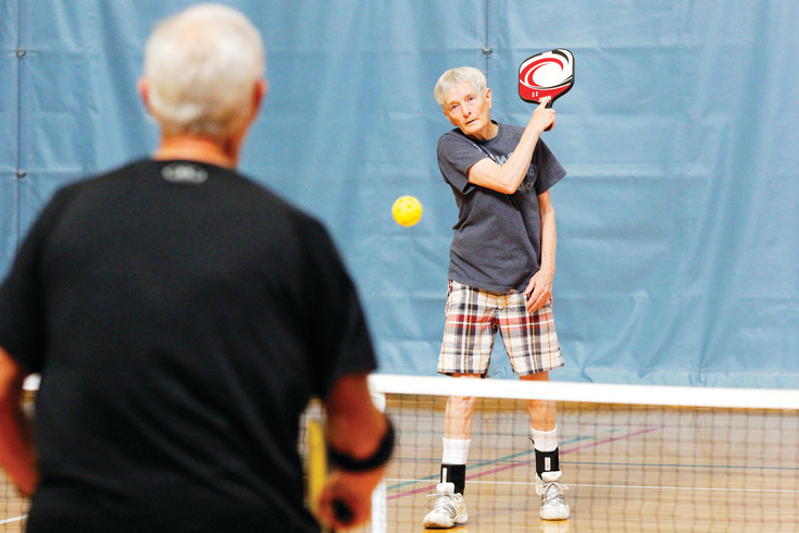 Jacy Showers, right, of Highlands Ranch fires a volley across the pickleball court at the Parker Fieldhouse on April 3. The sport is especially popular with seniors and many regulars at the facility's drop-in games are in their 70s and 80s, some are in their 90s.
