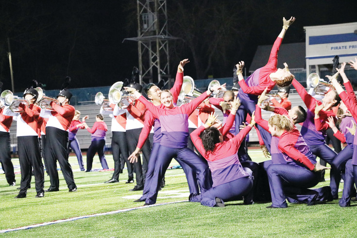 "The Blue Knights-Bahrain ensemble performs Michael Jackson's ""Thriller"" at a send-off concert and dress rehearsal at Englewood High School on April 11. The 100-person group left for Bahrain, an island in the Persian Gulf, the following day to perform at the Grand Prix, a Formula One Championship car race."