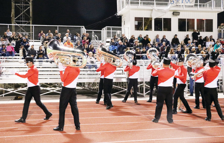 The Blue Knights-Bahrain ensemble performs upbeat tunes for friends and family at a farewell performance at Englewood High School on April 11. The 100-person group left for Bahrain, an island in the Persian Gulf, the following day to perform at the Grand Prix, a Formula One Championship car race.