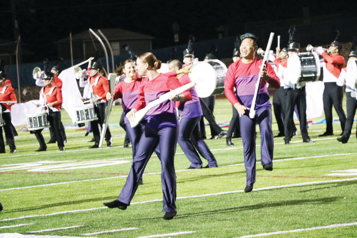 The Blue Knights-Bahrain color guard puts on an lively show at a send-off concert at Englewood High School on April 11. The ensemble left for Bahrain the following day to perform at the Grand Prix, a Formula One Championship car race.