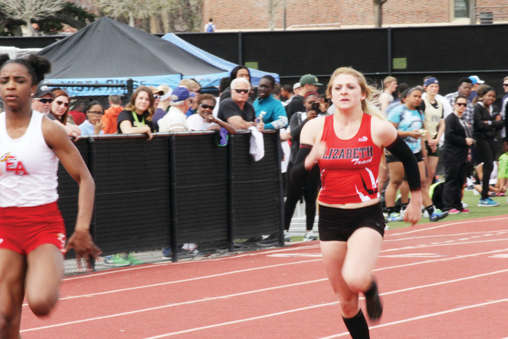Kallaway Wood pushes the pace as she competes in the 100-meter dash at the April 7 Thomas Jefferson Twilight Invitational Track Meet. Wood finished second in the event as the Cardinal girls were seventh in points among the 26 teams at the meet.