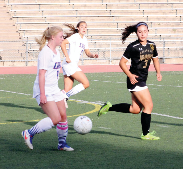 Cherry Creek's Meg Halvorson controls the ball as Arapahoe defender Elena Jauregul (3) watches. Halvorson had a goal and three assists as Creek scored four goals in the second half to post a 4-0 Centennial League win over rival Arapahoe.