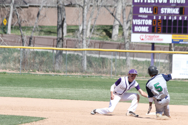 Littleton shortstop Nick Caswell applies the tag to Standley Lake's Gustavo Tafoya-Fernandez during the April 15 league baseball game. The runner was out trying to steal second and the Lions went on to win the game, 15-5.