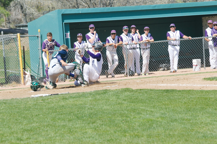 Sam Kail slides safely across the plate to score a run for Littleton during the April 15 league baseball game against Standley Lake. The Lions scored eight runs in the home half of the fifth inning to win the game, 15-5.