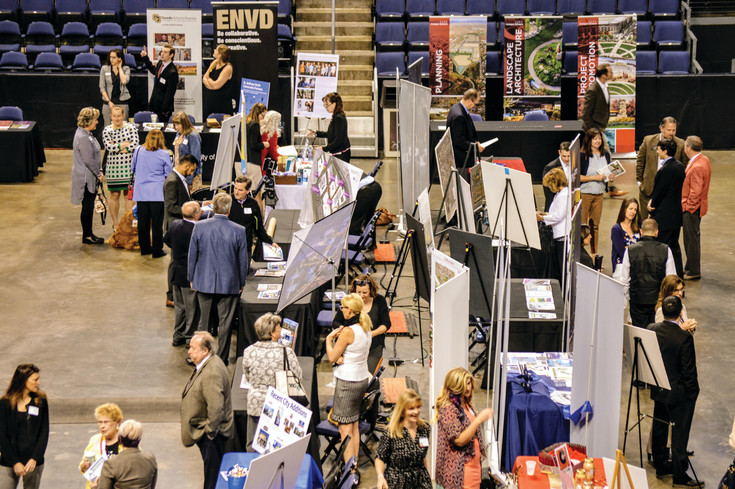 Local business owners take in the booths April 13 at the Metro North Chamber of Commerce's State of the Region conference at 1st Bank Center in Broomfield.