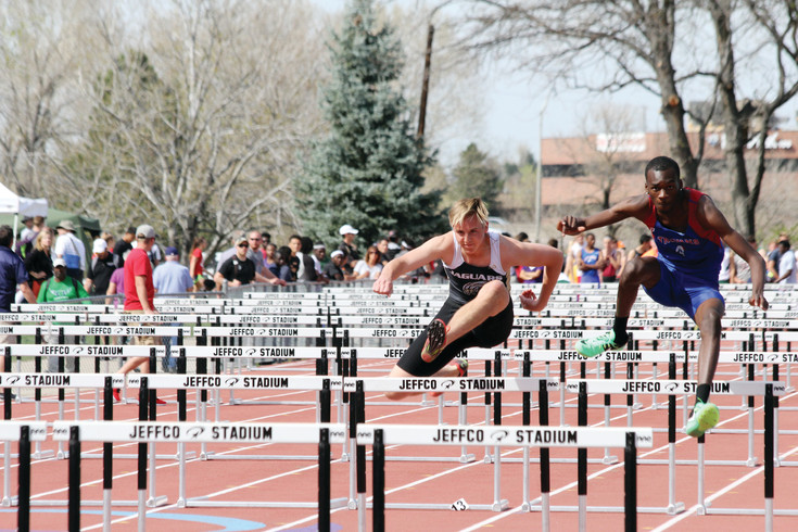 Luke Pousma clears the hurdle as he competes for Rock Canyon in the 110-meter high hurdles event at the April 14-15 Pomona Invitational Track Meet. Pousma ran the event in a time of 17.56 seconds, which earned him a 57th place finish among the 67 athletes who competed in the event. The Jaguar boys earned a total of 45.5 points and finished fifth among the 34 teams at the meet.