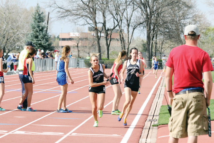 Sammy Spindler heads off the track after passing the baton to Rock Canyon teammate Kailey Rex so she can run the anchor leg of the 4 x 800-meter relay at the April 14-15 Pomona Invitational Track Meet. The Jaguars team finished fifth in the event with a time of 10:23. 08.