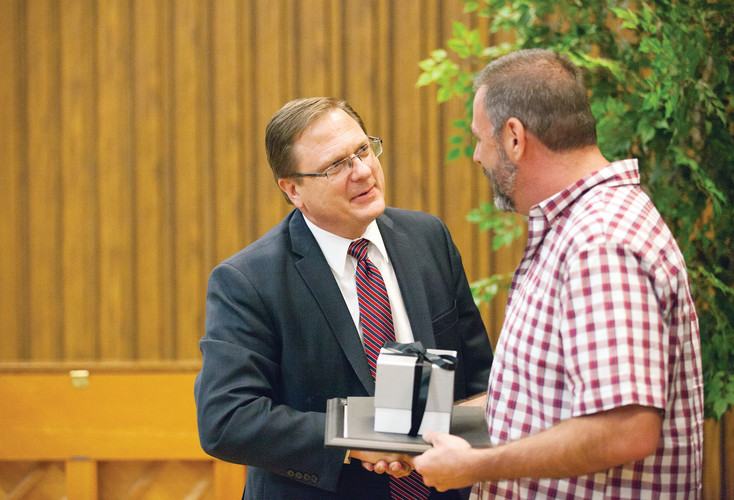 Mark Sabey, president of the Littleton Colorado Stake, gives an award to teacher honoree Garren Cuthrell of Heritage High School at the 2016 Teacher Appreciation Dinner sponsored by the Littleton Stake of the Church of Jesus Christ of Latter-day Saints on April 12.