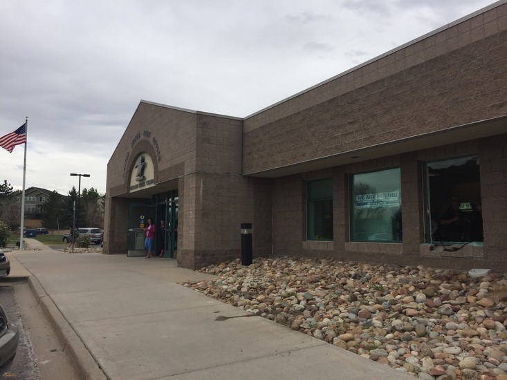 A vehicle went through the front window of the United States Postal Service in Highlands Ranch.