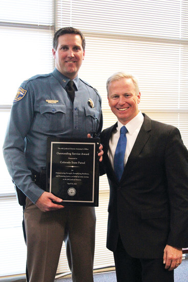 "18th Judicial District Attorney George Brauchler presents Lt. Col. Matt Packard with an ""Outstanding Service Award"" honoring the Colorado State Patrol."