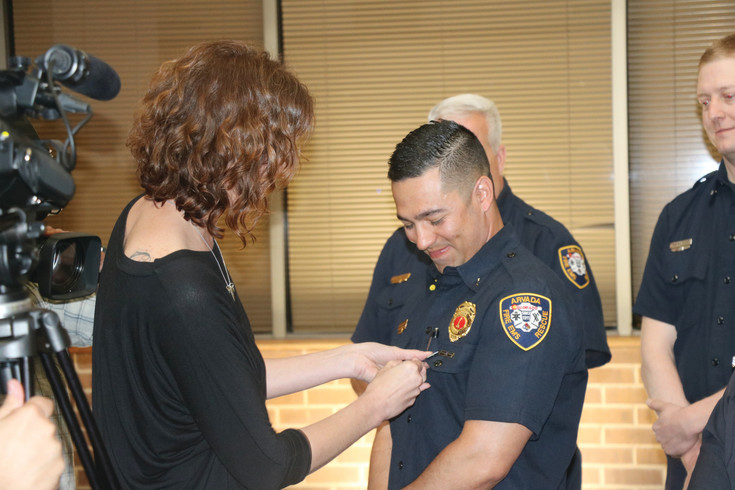 Diane Eckert, who lost her brother Cody Crosby in a car accident in 2013, pins a Donate Life pin on an Arvada fire fighter as her way of saying thank you during an event on April 11 to celebrate Donate Life month.