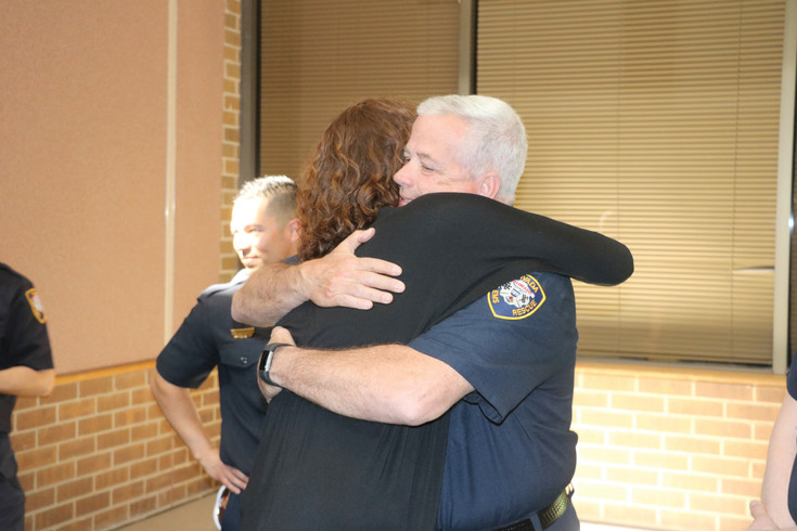 Diane Eckert, who lost her brother Cody Crosby in a car accident in 2013, hugs a member of the Arvada firefighters and paramedics. Eckert, her parents, and the recipients of Crosby's organs, all met at the police department on April 11 in honor of Donate Life month.