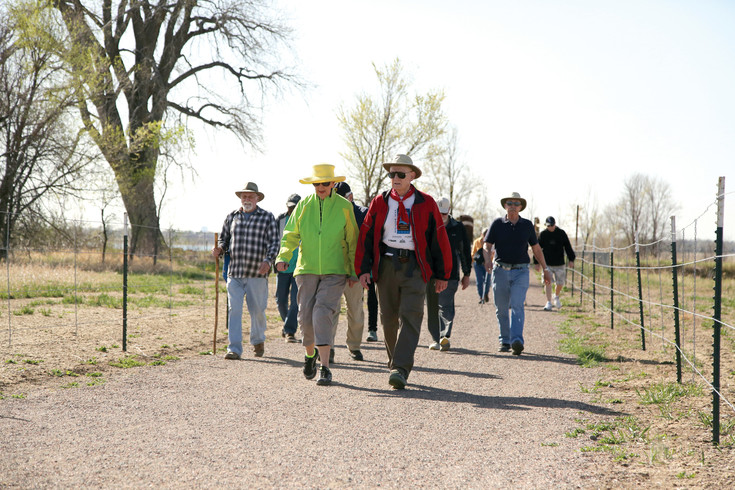 Mark McGoff (red jacket) leads a community hike in Arvada once a month.