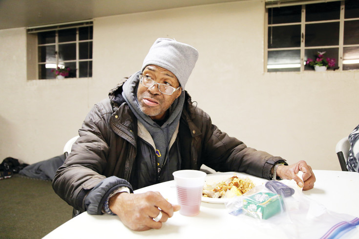 James Lee Bolton Jr. finishes his meal at Sloan's Lake Community Church before cleaning up and setting his bed up for the night on March 31. He is one of 30 homeless singles in the Central Jeffco area who stayed at the church, which is part of the Severe Weather Shelter Network.