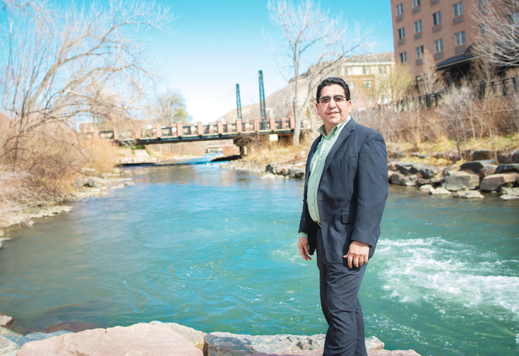 Joe DeAguero, 51, stands along Clear Creek in Golden in May last year. DeAguero of Wheat Ridge is a financial adviser and published author who encourages everyone to become involved in their community.