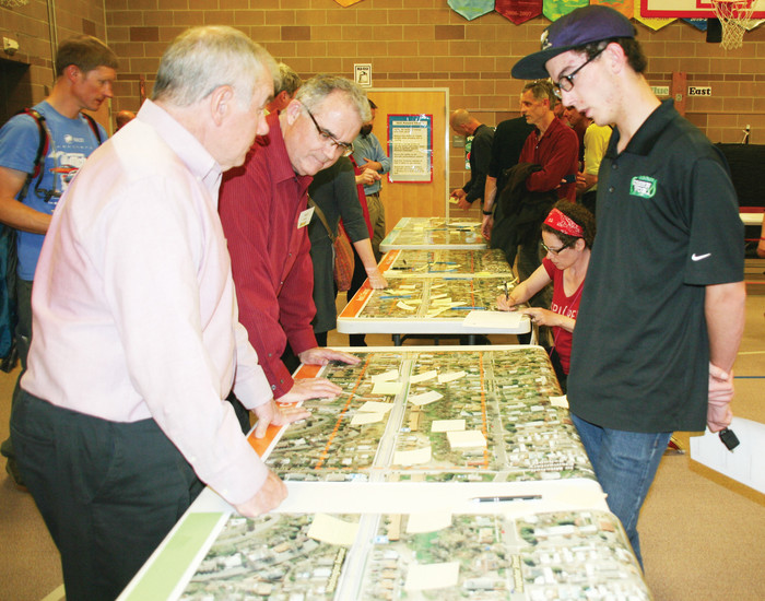 Dan Hartman, the City of Golden's director of public works, left front, talks with Golden residents about some improvements proposed for North Washington Avenue during an open house meeting on April 11.