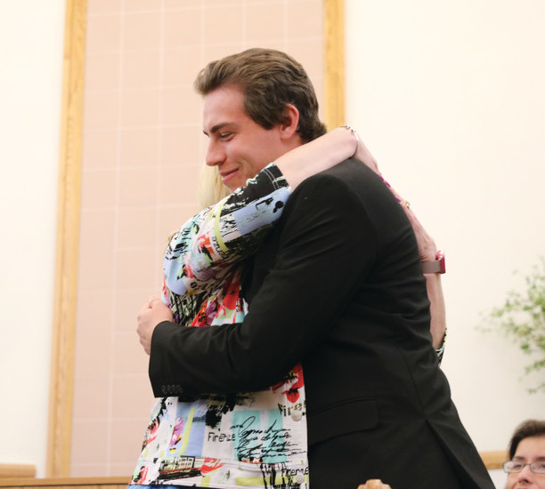 Rock Canyon High School senior Kenneth Groom hugs his teacher, Janna Robinett, after expressing his gratitude for her. The duo were one of about 100 teacher-student pairs that took the stage at the annual Teacher Appreciation Banquet on April 12.