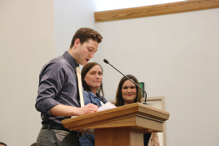 Pro basketball player Jimmer Fredette, of Roxborough, presents the awards at the Teacher Appreciation Banquet at the Church of Jesus Christ of Latter-Day Saints in Highlands Ranch on April 12.