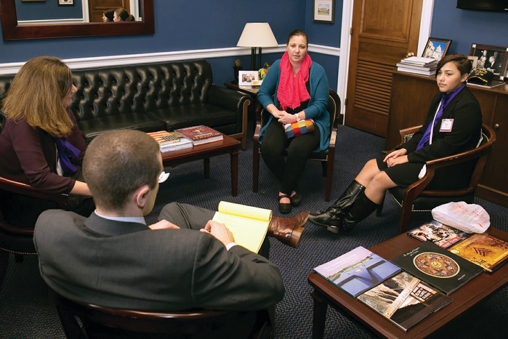 "Grace Garcia, right, and her mother Laurie, center, meet with aides for Congressman Mike Coffman in March in Coffman's Washington D.C. office. Garcia says epilepsy research is in a kind of ""neutral zone,"" without resources to make significant progress, and she fears for what could happen if funds for medical research are cut."