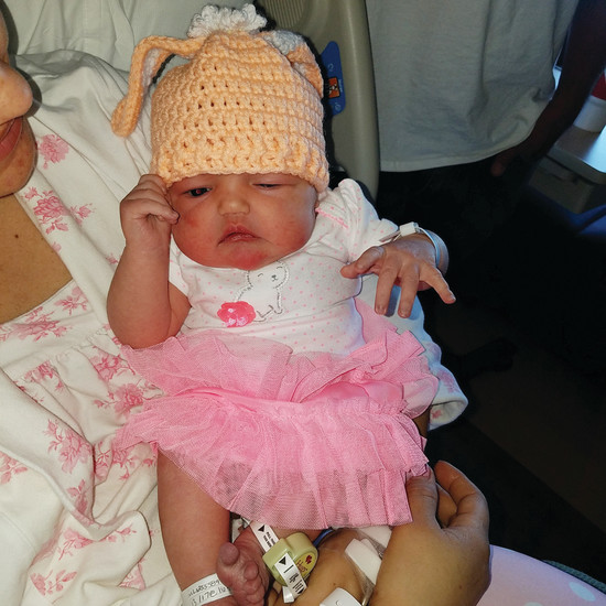 Infant Maggie Penniman wears a tutu and a new bunny beanie crocheted by the Needle Arts Guild, a volunteer group at Parker Adventist that creates handmade items for patients at the hospital. The group made over 1,600 pieces in 2016 alone.