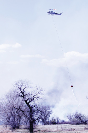 A Rampart helicopter drops water on a brush fire near Pine Drive and Twenty Mile Road in Parker on April 20. A caller reported the blaze at 12:23 p.m. Approximately 50 personnel and 20 engines were dispatched to the fire.