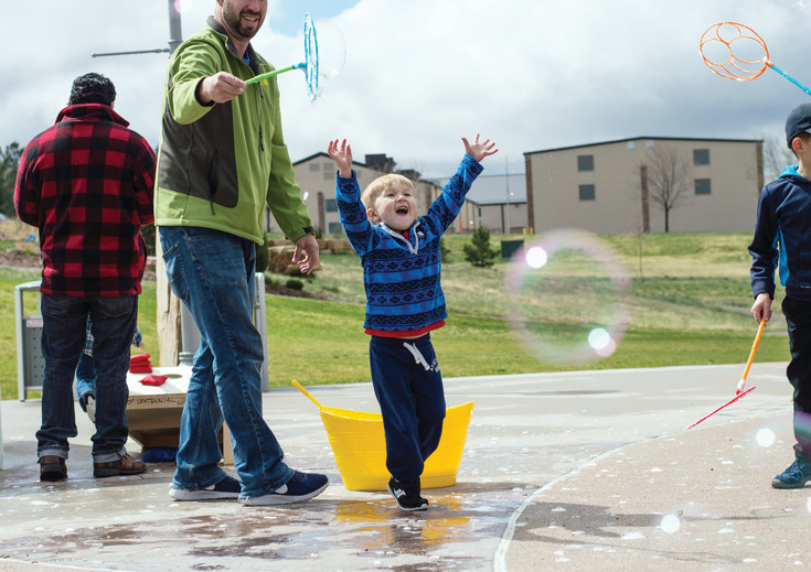 During Centennial's Earth Day celebration on April 22, children could throw giant seed balls at targets, play with bubbles and learn about plants in Colorado.