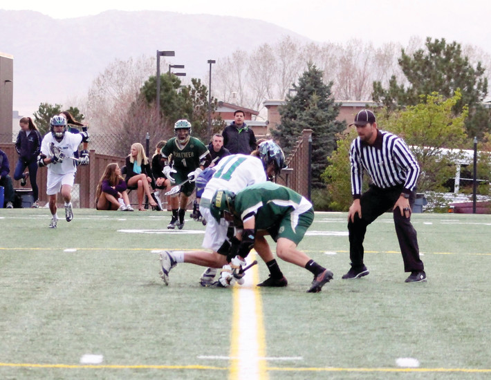 ThunderRidge senior Brett Naves wins a faceoff against Bear Creek's Charles Peterson during a April 10 game at Shea Stadium. Naves says faceoffs are one of the lesser known but most important parts of a lacrosse game.