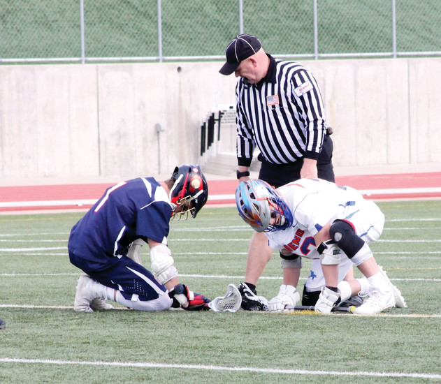 Chaparral's Brett Boos (blue) and Jake Hrovat of Legend prepare for a faceoff during an April 11 game at Echo Park Stadium. Boos leads Class 5A players in ground balls and is second in faceoff percentage and Hrovat is one of the area's top players in faceoff percentage statistics.