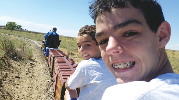 YMR club members Anthony and Joey Bund ride the rails at Colorado Live Steamers during a club outing.