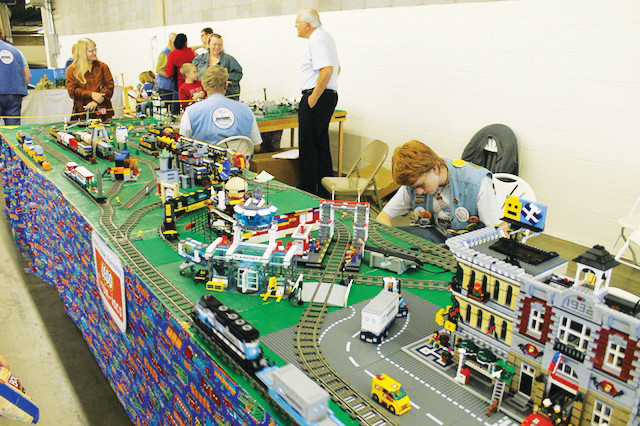 A YMR club member is available to answer questions about the Lego train layout during a previous train show.