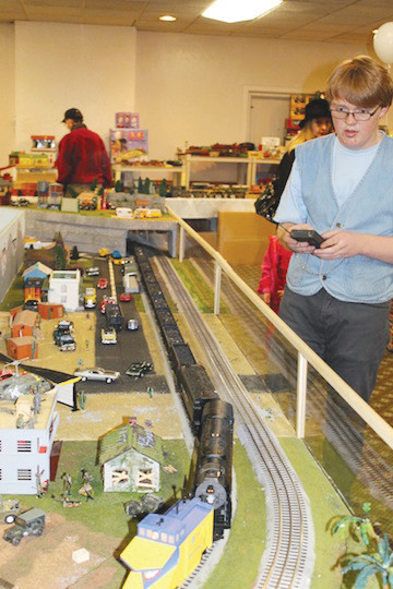 A YMR club member drives the O-Gauge model during a previous train show.