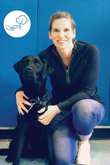 United States Army veteran Elise Hunt poses with her canine companion COWBOY. Hunt teamed up with students at North Star Academy Charter School in Parker to raise over $1,000 for paws4vets, a nonprofit that provides assistance and companion dogs to veterans.