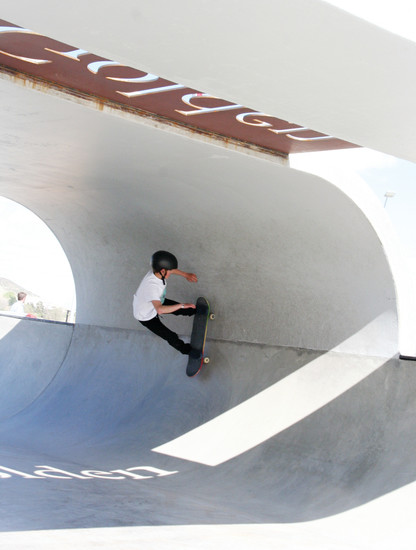 Jake Canter, 13, of Evergreen practices a trick at the new Ulysses Skate Park, 1181-1199 Ulysses St., in Golden on April 22, which was the grand opening of the new park.