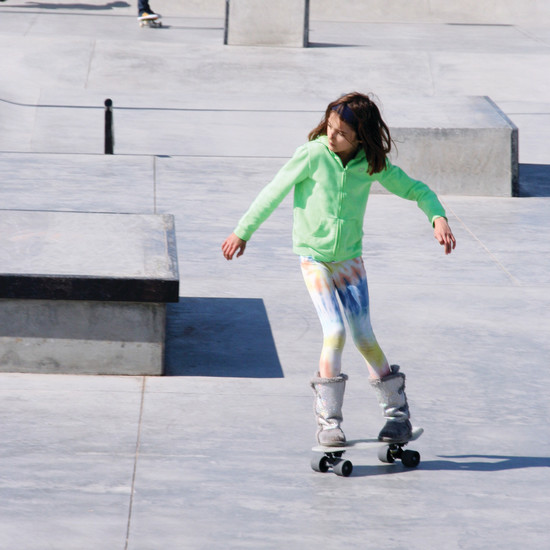 Maggie Pullol, 9, of Lakewood skates around on her skateboard on April 22 on the grand opening day of Ulysses Skate Park, 1181-1199 Ulysses St., in Golden.