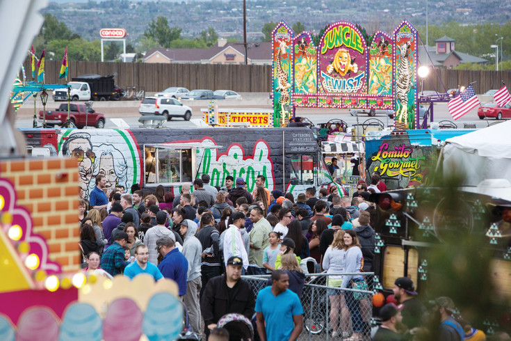 Crowds line up in front to get meals at Northglenn's 2016 Food Truck Carnival. Vendors said the 2016 event was easily one of the busiest events they attended last year and they expect the 2017 carnival will attract even bigger crowds.