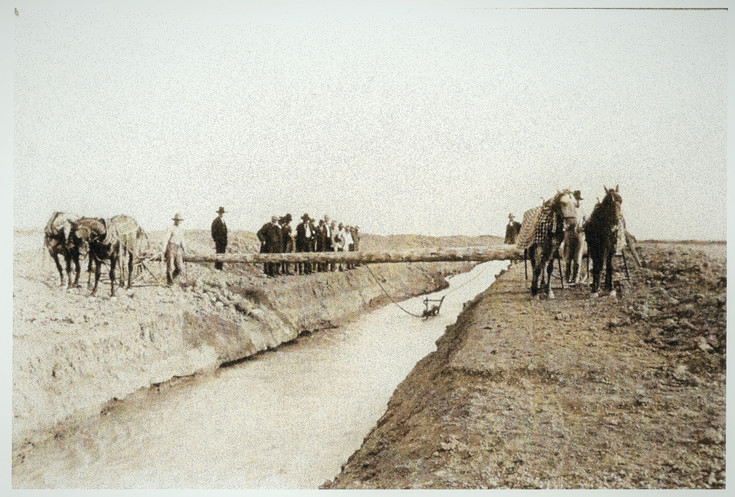 Horses drag a dredge along one of Westminster's early water canals in this old photograph from the Westminster Historical Society.