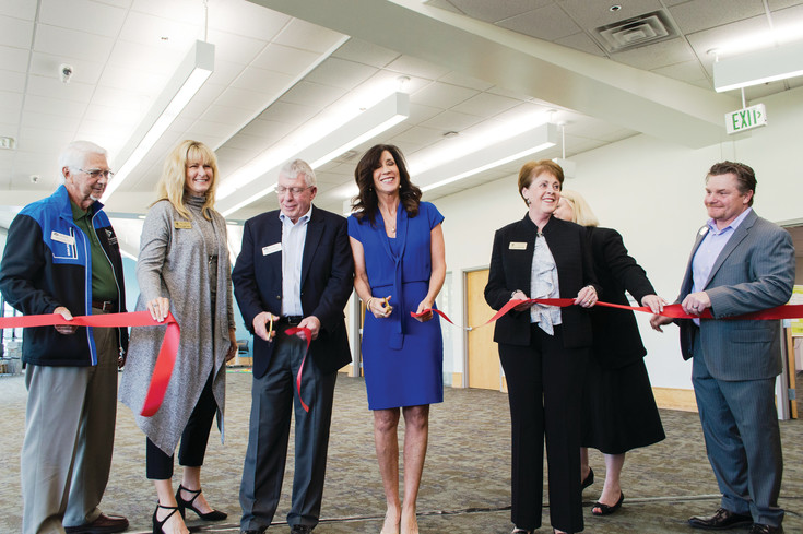 The City of Lone Tree and South Suburban Parks and Recreation District join together to cut the ribbon at the grand opening of the Lone Tree Hub on May 1.