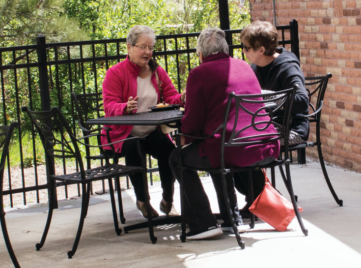 The Lone Tree Hub has a patio for residents to enjoy the weather and get together.