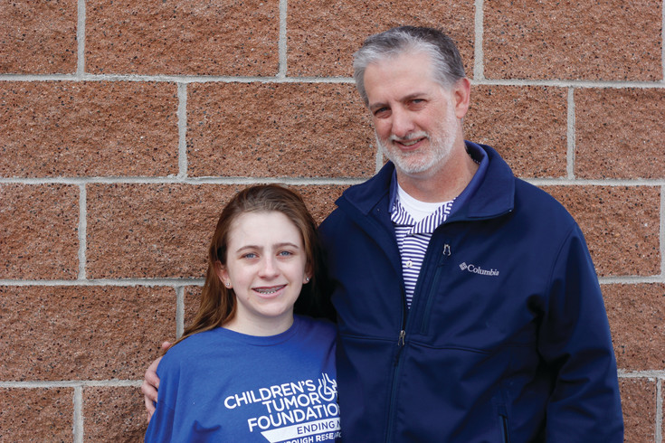 Presli Collins and her father Andy pose together on their way to Children's Hospital in Aurora for surgery to remove a tumor from a nerve on the side of her rib cage. Collins has neurofibromatosis 1, which causes tumors to grow on the nerves in her body.