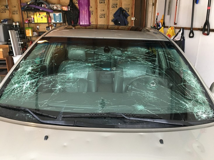 The windshield and hood of Green Mountain resident Stephanie Burnett's Toyota after it was caught in the parking lot of Colorado Mills on May 8, during the particularly violent hail storm that swept through the Front Range. She said the vehicle repair cost will likely exceed the car's value.