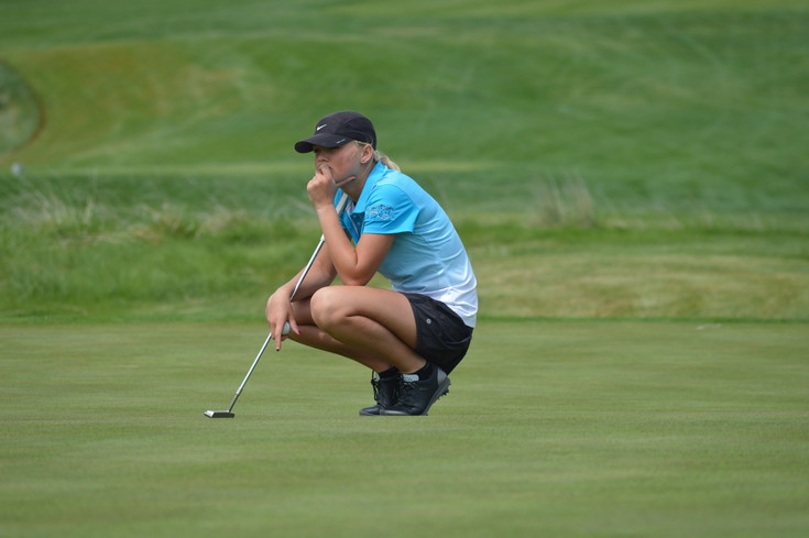 Riley McKibbon of Ralston Valley looks over a shot and she will be competing for the Mustangs in the Class 5A state golf championships May 22-23 at The Club at Rolling Hills.  Ralston Valley looms as one of the team favorites in the two-day chase for the state title.l