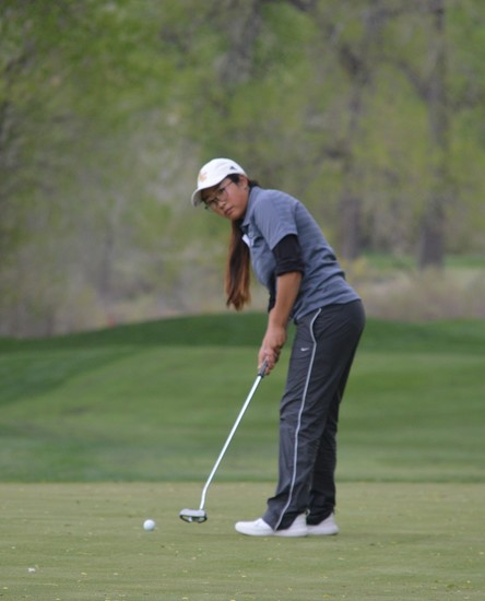 Rock Canyon's Amelia Lee watches her putt on the final green of the Western Regional golf tournament May 8 at Fox Hollow. Lee finished second in the qualifying tourney and will be a part of the Jaguars' team that will compete in the Class 5A state golf tournament May 22-23 at The Club at Rolling Hills.