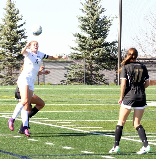 ThunderRidge junior Shae Holmes heads the ball during the May 12 second round soccer game against Arapahoe at Shea Stadium. The Warriors played solid defense and won the game,1-0, on a free kick by Sydney Maxson.