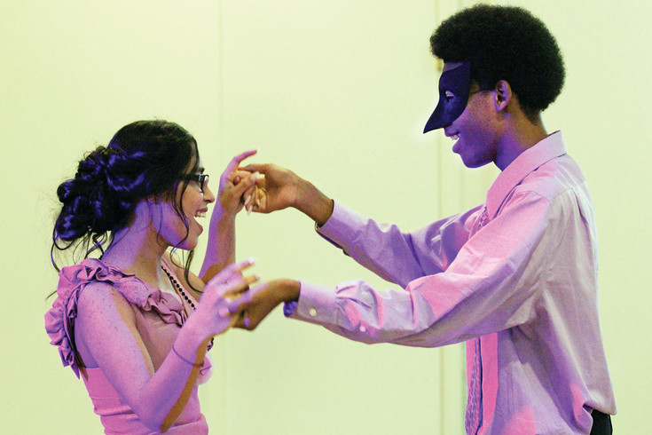 "Yadira Velez, 16 , and Keiren Brown, 17, share a dance at the ""Black and Gold Masquerade,"" a prom for online high school students from across the state. Brown and Velez met at last year's prom and stayed in touch via Facebook throughout the year."