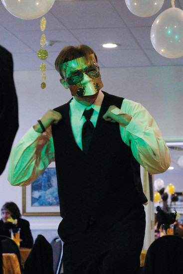 "Patrick Borchert, 16, a student at Destinations Career Academy, gets the party started at the online students' prom on May 5. ""I thought I'd be the shy guy, but I was the first one on the dance floor,"" he said."