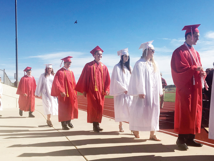 As a hawk soars overhead, seniors of Elizabeth High School walk to their seats for the commencement ceremony May 13.