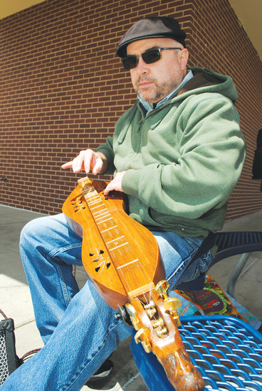 Bud Ford, employee of Northglenn Natural Grocers, has played the dulcimer since he was 13 years old.